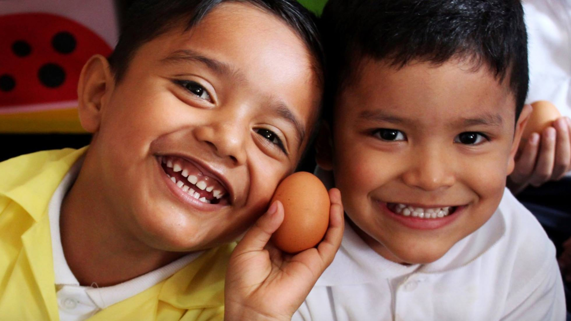 two boys with an egg