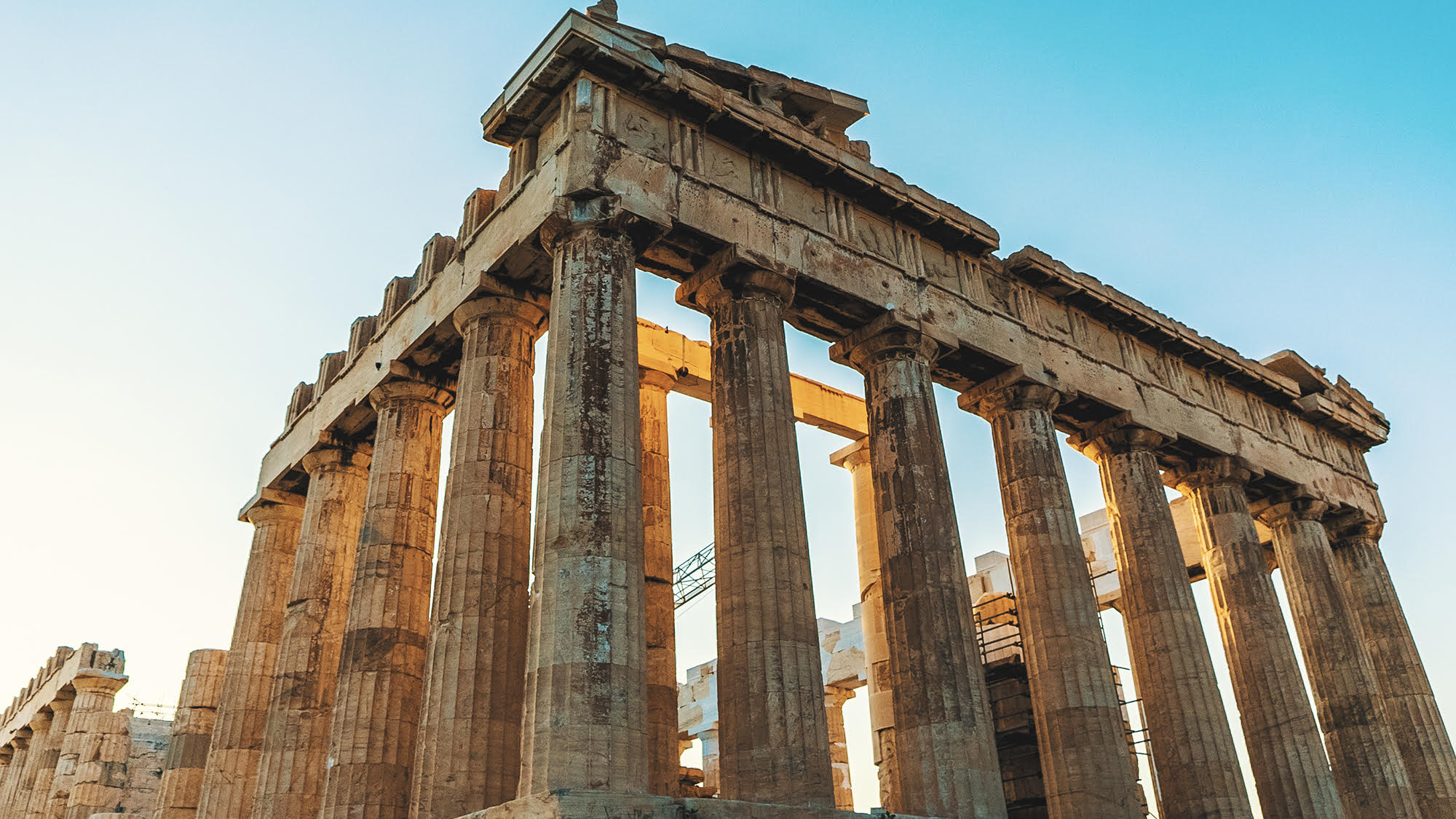 Image of the Parthenon in Athens, Greece with sun shining in background