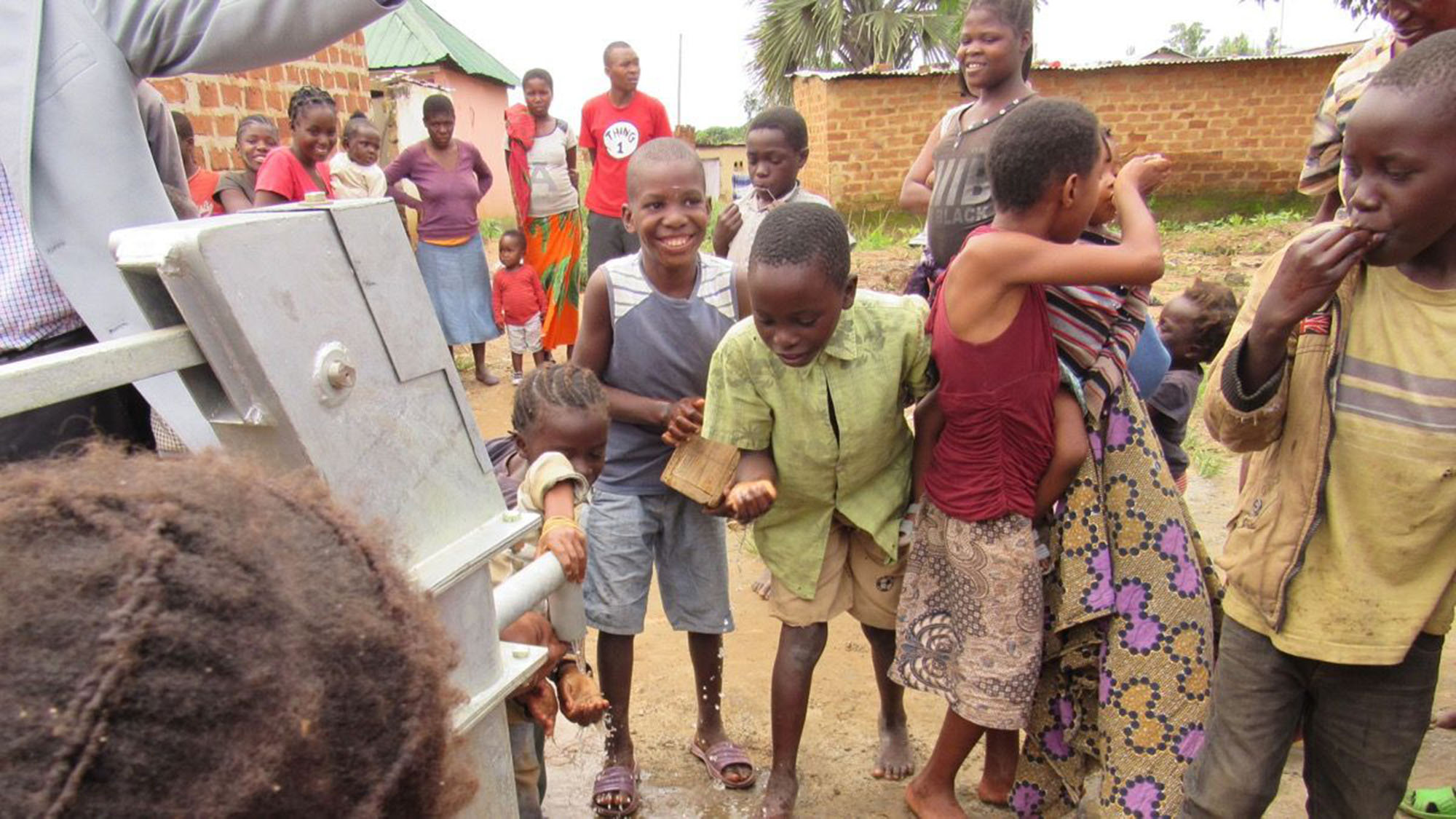 Children at a water pump