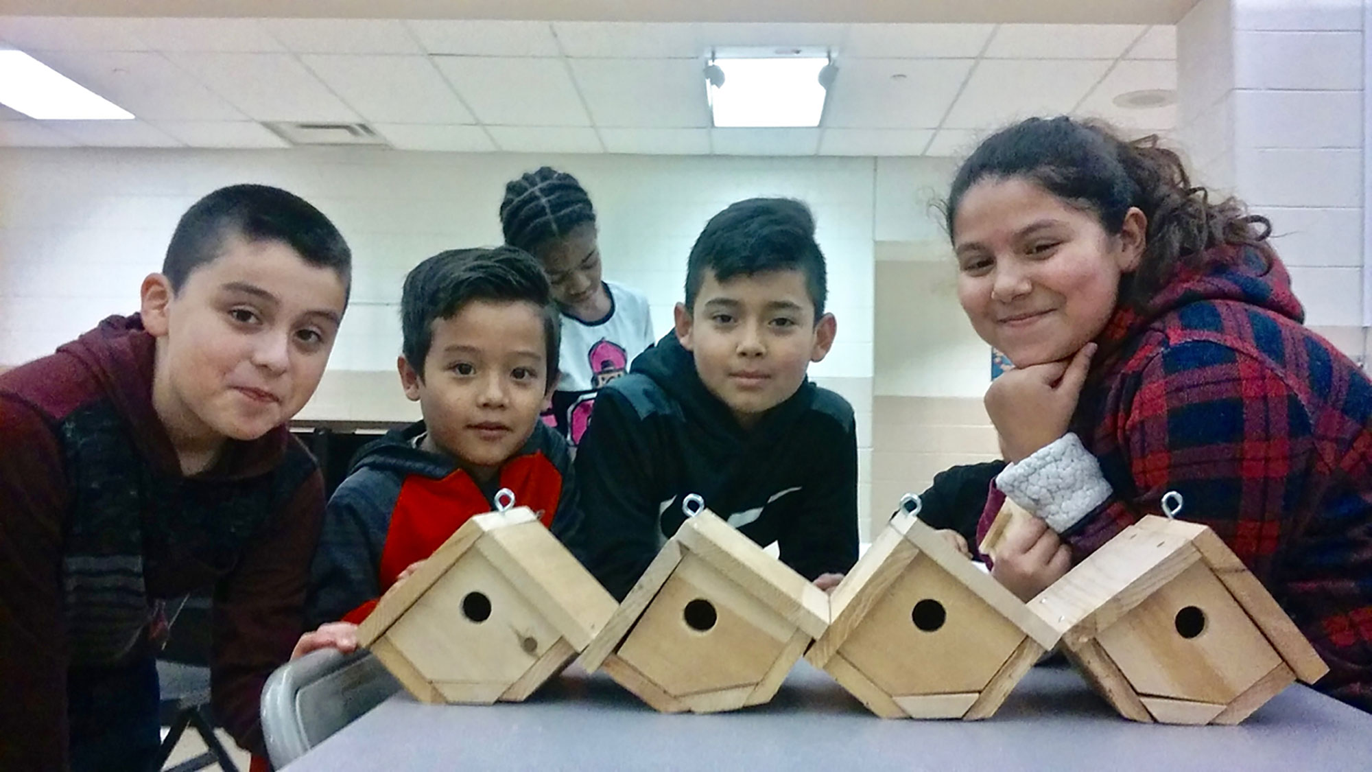 Photo of youth with bird houses