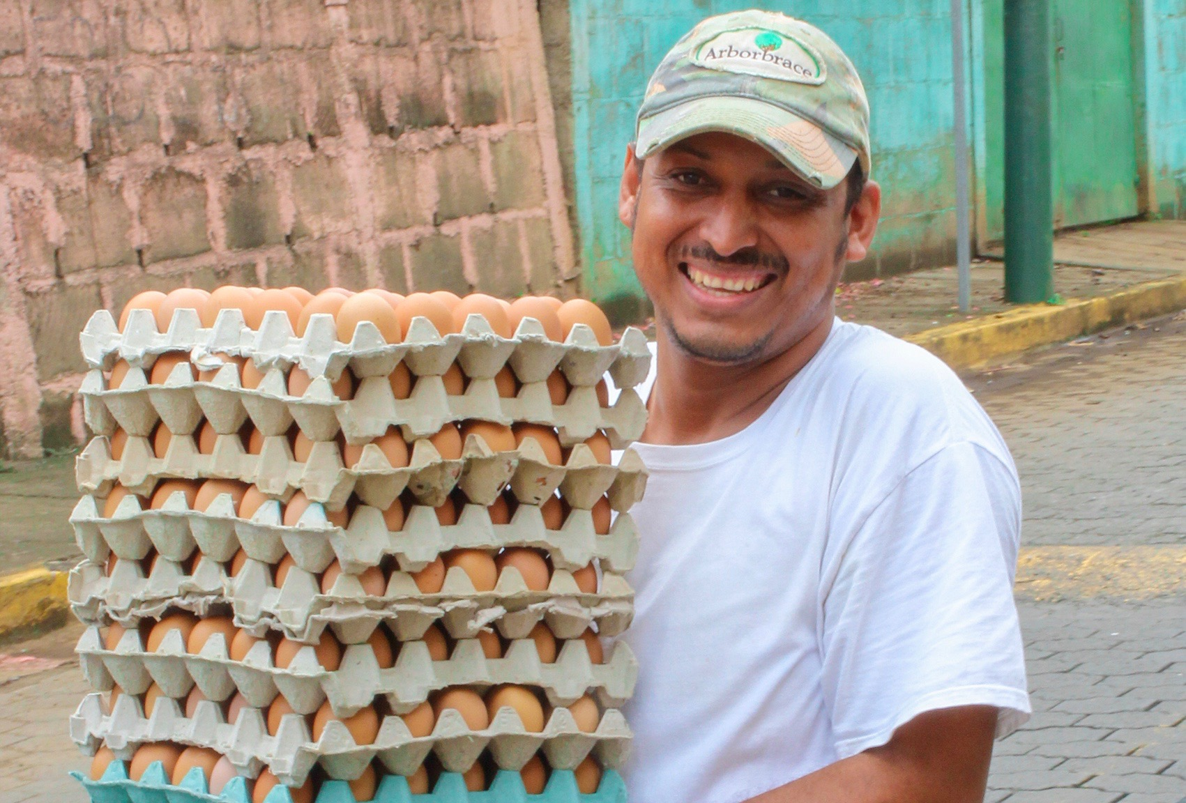 Man carrying trays of eggs