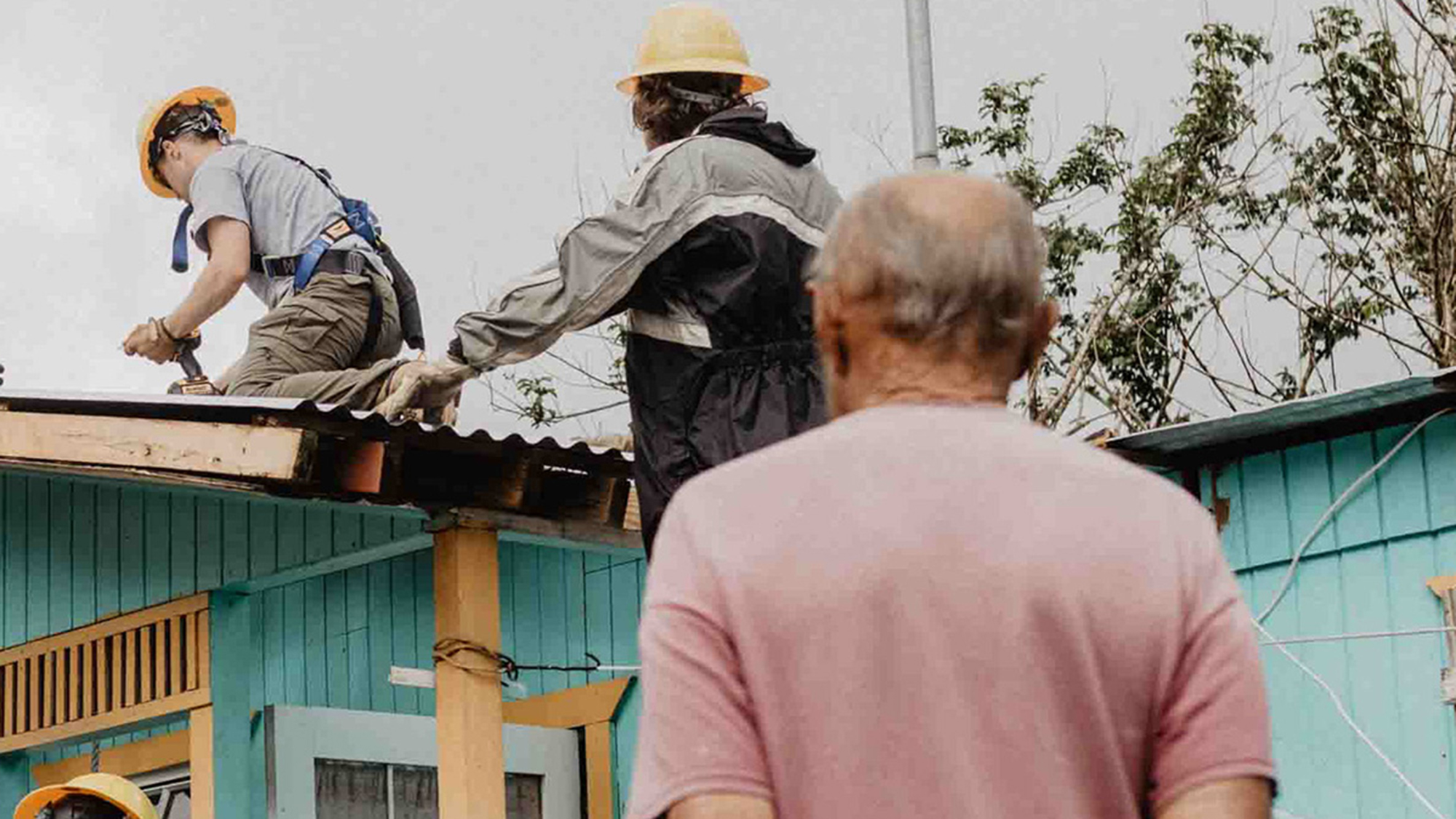 People working on a roof