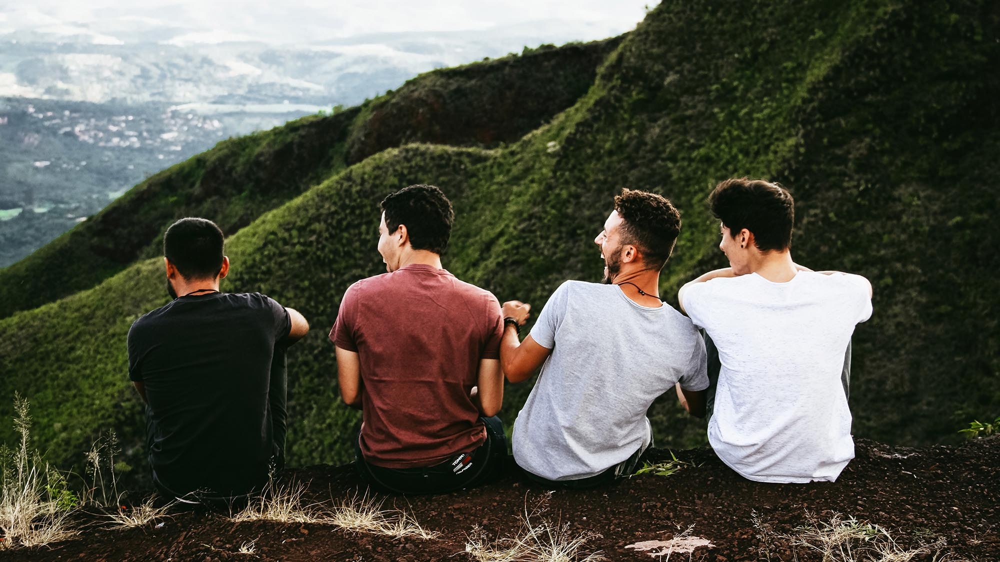 image of guys on hillside